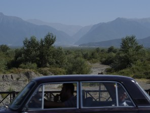View up into the Greater Caucasus - and, oh, a Lada.