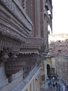 Huge facades of intricately carved red sandstone.