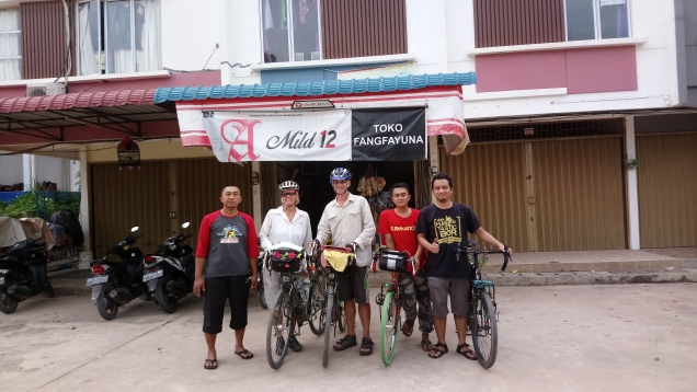 In Batam we were kindly hosted for three nights by Indonesian cyclist Zainal. Who took this photo of us with his mates. But where's he?