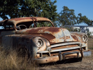 Farmers abandon old vehicles, like many places. They don't rust much, and nothing grows on them. Forty years later, they're still there.